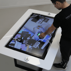 man using touch table