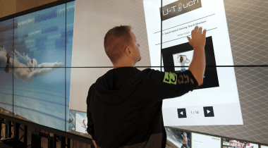 man using LED touch wall