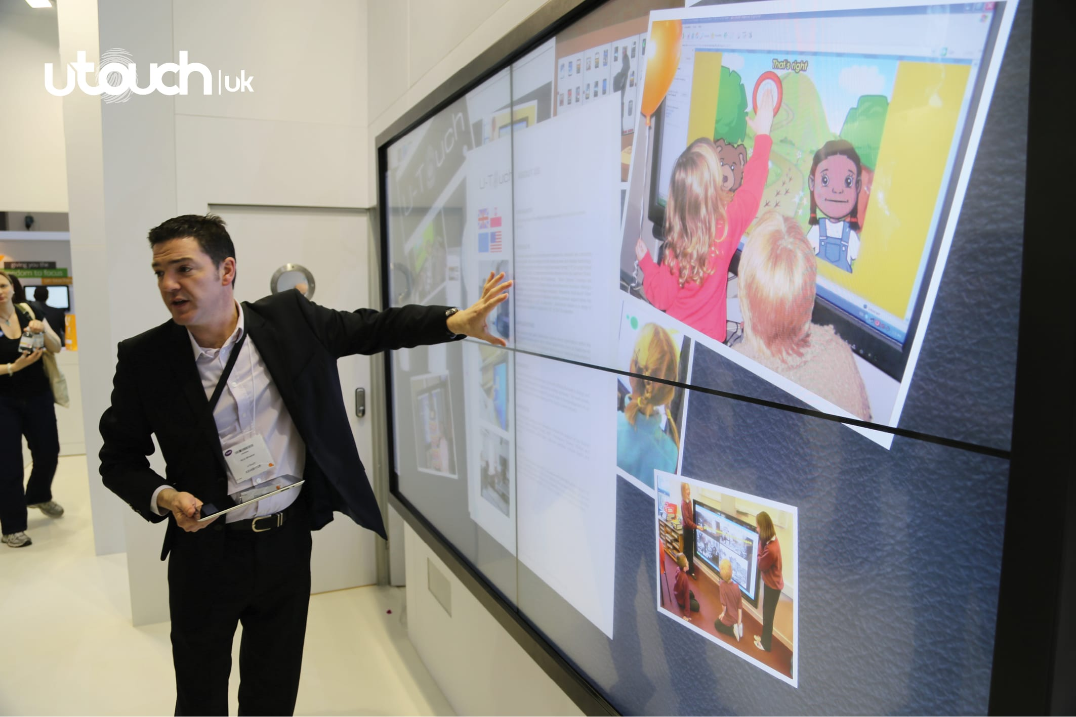 man demonstrating interactive touch wall